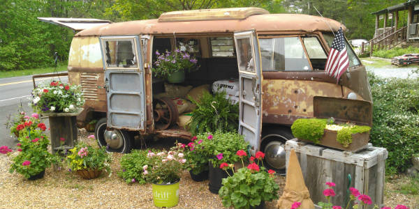 Today's Travel Thursday photo is of a rusted VW van surrounded by potted flowers I saw when driving through Metone, Alabama.